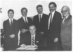 Senior Deputy Assistant Secretary of State, Robert Funseth, and other staff in Hanoi to negotiate and sign the agreement between the U.S. and Vietnam, July 1989
