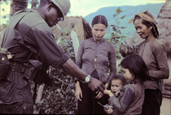soldier with Vietnamese villagers and children
