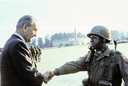 soldier shaking President Johnson's hand