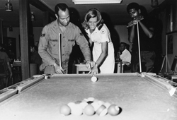 Jennifer Young playing pool with soldiers