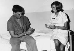 Jennifer Young playing cards with a soldier