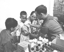 US Army civic action during the reoccupation of Reich Kieu District, Long An Province.: Douglas Pike Photograph Collection [VA002042]