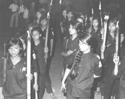 Torch bearing female Self-Defense Cadres.: Douglas Pike Photograph Collection [VA003080]