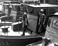 Republic of Vietnam... Adm. Elmo R. Zumwalt, Jr., Chief of Naval Operations, inspects a Vietnamese Inshore Patrol Craft (PFC) at the An Thoi Naval Base. With him is the bases senior US naval Advisor, CDR. Maurice J. Shine: Admiral Elmo R. Zumwalt, Jr. Collection [VA016621]