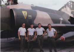 Ubon Royal Thai AFB, Thailand - Aircraft F-4 Phantom II #FG 65746 - 1000 lb Laserguided Paveway Bomb<br><br>433rd Tactical Fighter Squadron, 8th Tactical Fighter Wing  - Weapons Load Crew, left to right:  Staff Sergeant Robert Santo, Glencove, NY; Sergeant Barry Waters, Tampa, FL; Sergeant Jay D. Walker, Hickory, NC; Sergeant James Van Portfliet, Marne, MI: Robert Santo Collection [VA048158]