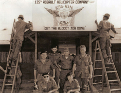 135th Assault Helicopter Company, USA-RAN, EMU - Get The Bloody Job Done<br><br>Kneeling (left to right): Lt. Bob Ray, RAN; Leading Seaman R.M. Brennan, RAN<br><br>Standing (left to right): Lt. cdr Graham Rahrsheim, RAN; Lt. Max Speedy, RAN; Maj. Paul Raetz; 1SG Judy: John H. (Jack) Salm, Jr. Collection [VA054118]