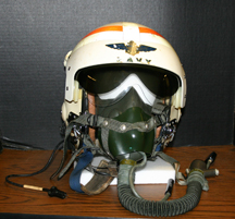 U.S. Navy flight helmet with boom mike, and oxygen mask attached. Commander B.C. Rudy marked on back of helmet. Red carrying bag also included