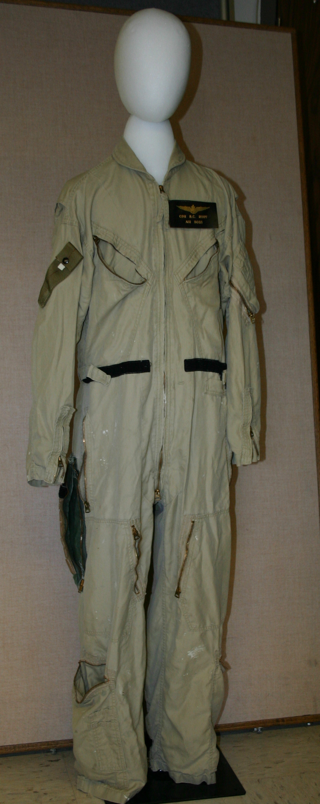 U.S. Navy summer flying coveralls with U.S. Naval Aviator identification patch that says CDR B.C. Rudy, Air Boss