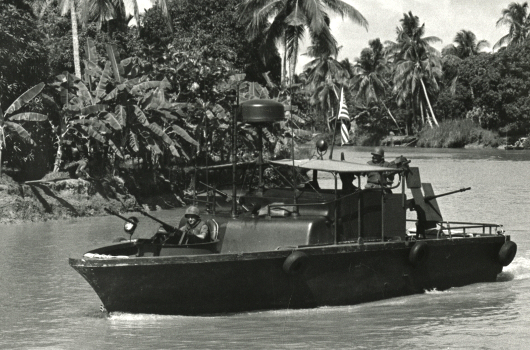 Commander U.S. Naval Forces Vietnam, A U.S. Navy River Patrol Boat Cruises slowly down a canal in the Mekong Delta of S. Vietnam. The 31 Foot craft Patrol the Waterways of the Mekong Delta and rung Sat Special Zone to prevent the Viet Cong from moving supplies by water. The PBRs are propelled by water jets and can travel in water less than a foot deep.
