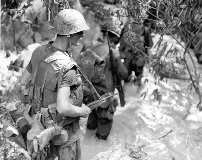 "Operation Prairie III-- Marines of ""A"" Company, 1st Battalion, Ninth Marines, move through a stream in search of North Vietnamese soldiers during Operation Prairie III approximately three miles west of Cam Lo."