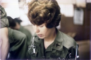 Photo of 1st Lieutenant Cheri Hawes, US Army Nurse Corps, at desk for Emergency Room, 91st Evacuation Hospital, Chu Lai, Vietnam