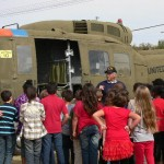 Waters Elementary students view Huey helicopter.